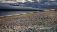 Eastern Icelandic mist begin to disappear when the sun start heating up the land photo by karl magnusson