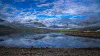 The clouds and rest of the mist in Faskrudsfjordur, Eastern Iceland photo by karl magnusson