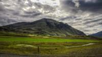A farm under the mountain in Álftafjordur, Eastern Iceland photo by karl magnusson