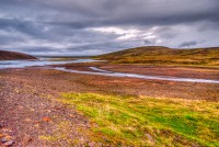 View over river running through the Highlands of Iceland on the route over Kjölur photo by karl magnusson