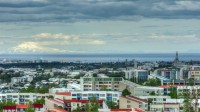 View over Reykjavik toward Snæfellsjökull with Perlan and Hallgrímskirkja photo by Karl Magnusson
