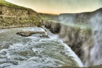 The golden waterfall Gullfoss falling into the canyon in Southern Iceland photos by karl magnusson