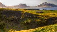View over Trékyllisvik and Norðurfjörður with mr. Krossnessfjall on right and Urðartindur on left, Strandir in Westfjords of Iceland photos by karl magnusson