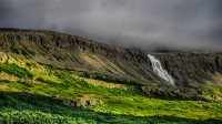 The waterfall Dynjandi one foggy day in Westfjords of Iceland photos by karl magnusson