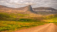 View into the valley Hvestudalur and mt. Nónfell in Arnarfjörður in Westfjords of Iceland photos by karl magnusson