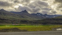 The farm and it's surrounding mountains in Hamarsfjordur, Eastern Iceland photo by karl magnusson