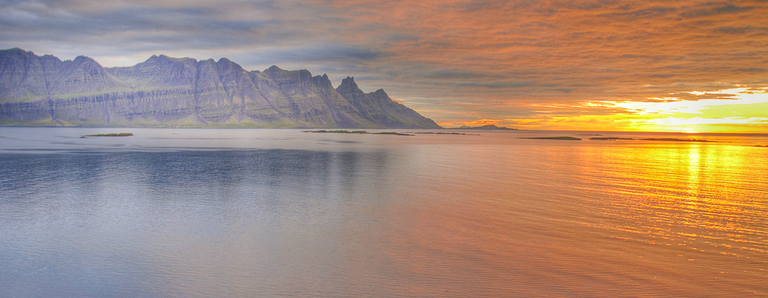 Breiðdalsvik one calm day when the sun was rising in Eastern Iceland photo by karl magnusson