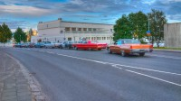 Old cars in line in front of the Reykjavik Swimmingpool Hall