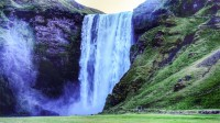 The waterfall Skógarfoss in Southern Iceland photos by karl magnusson