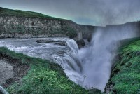 The golden waterfall Gullfoss throwing water in all directions in Southern Iceland photos by karl magnusson