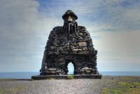 Sculpture of steinkarlinn Bárður Snæfellsás in Arnarstapi Snæfellsnes, Western Iceland photo by karl magnusson
