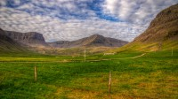 View into the valley Bakkadalur with mt. Grandahorn and mt. Nónhorn in Arnarfjörður in Westfjords of Iceland photos by karl magnusson