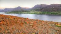 View into Álftafjörður and Súðavik in Westfjords of Iceland photos by karl magnusson